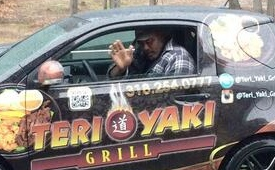 Karl Malone In A Really Small Car