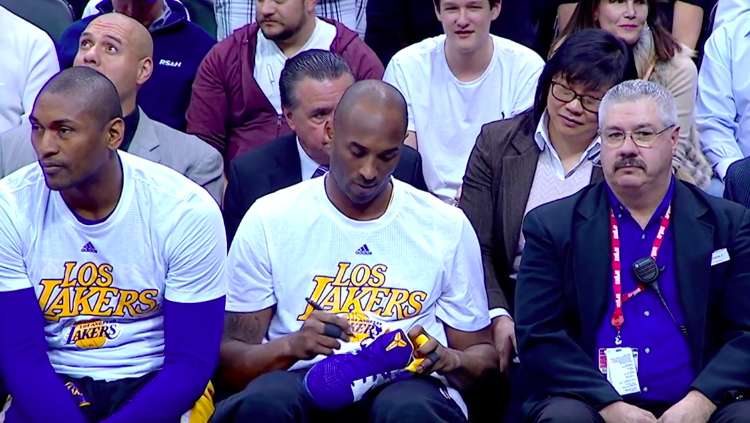Kobe Bryant Gives Young Fans His Shoes In Last Denver Game