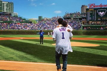 Derrick Rose and Son Throw Out First Pitch at Cubs Game